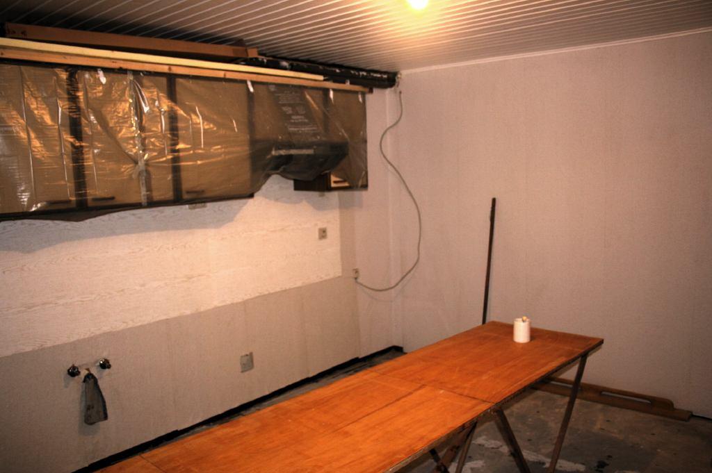 Behangen Keuken : Folie tegen de keukenmuur